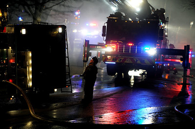 Sarah Nader - snader@shawmedia.com Firefighters work to extinguish a fire at a home on Monday night on the 1100 block of Spring Hill Drive in Algonquin on February 20, 2012.