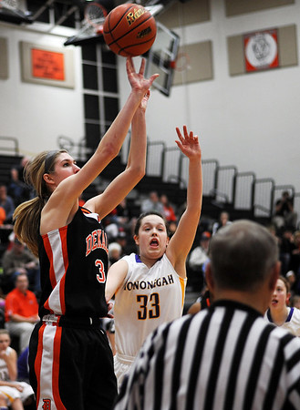Sarah Nader - snader@shawmedia.com DeKalb's Courtney Bemis (left) is guarded by Hononegah's Liz Jordan while she shoots during the second quarter of Monday's Class 4A McHenry Sectional in McHenry on February 20, 2012