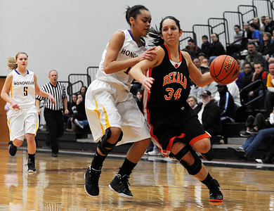 Sarah Nader - snader@shawmedia.com DeKalb's Rachel Torres (right) is guarded by Hononegah's Tiana Thomas while she brings the ball down court during the first quarter of Monday's Class 4A McHenry Sectional in McHenry on February 20, 2012