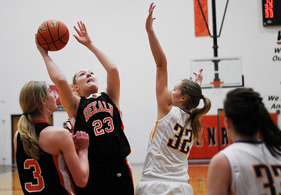 Sarah Nader - snader@shawmedia.com Hononegah's Becky Dal Santo (right) guards DeKalb's Maddy Johnson while she takes a shot during the second quarter of Monday's Class 4A McHenry Sectional in McHenry on February 20, 2012