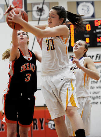 Sarah Nader - snader@shawmedia.com DeKalb's Courtney Bemis (left) and Hononegah's Liz Jordan both fight for the rebound during the first quarter of Monday's Class 4A McHenry Sectional in McHenry on February 20, 2012