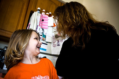 Lance Booth - lbooth@shawmedia.com Brianna Barker, left, talks to her adoptive mother Tammy Barker, both of McHenry on Monday, February 20, 2012. Brianna has non-hodgkin lymphoma, which is in remission. Her family has received around $5,500 from the St. Baldrick's fundraiser to help with medical bills.