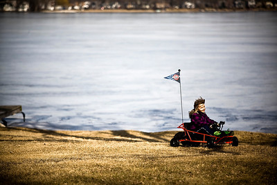 Lance Booth - lbooth@shawmedia.com Brianna Barker, 7, of McHenry, drives a go-kart around the backyard of her home on Monday, February 20, 2012. Brianna has non-hodgkin lymphoma, which is in remission. Her family has received around $5,500 from the St. Baldrick's fundraiser to help with medical bills.
