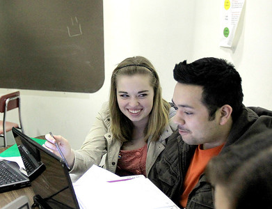Sandy Bressner - sbressner@shawmedia.com Hannah Swerbenski, 15, of Crystal Lake works with classmate Uriel Ramirez, 17, during her microbes and disease class at the Illinois Math and Science Academy in Aurora.