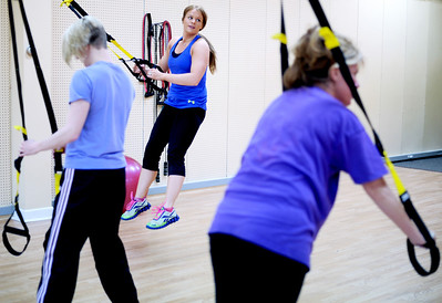 Sarah Nader - snader@shawmedia.comPersonal trainer Melissa Griffin (center) teaches a TRX class at HigherGround Fitness in Woodstock on Tuesday, February 21, 2012. In March Griffin is going to launch a non-profit aimed at helping young women overcome body image issues.