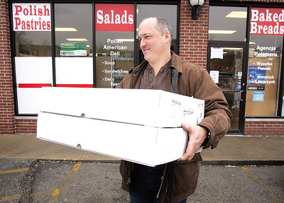 H. Rick Bamman - hbamman@shawmedia.com  Todd Boccabella of picks up his order of 170 Rosmart Deli paczkis for employees at Stanley Machining and Tool Corp. in Carpentersville.