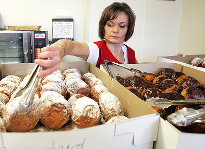 H. Rick Bamman - hbamman@shawmedia.com  Rosmart Deli employee Kathy Pinkosz-Kolenda fills a Paczki order Tuesday morning in Algonquin. The paczki, a doughnut-like pastry that originated in Poland, is a popular seller just before Lent.