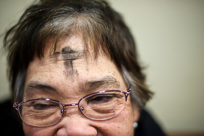 Daniel J. Murphy - dmurphy@shawmedia.com  Leonida Pureza of Algonquin received an ash cross on her forehead at St. Mary's Catholic Church in Huntley. Today marked the beginning of Lent and the 40 days of fasting leading up to Easter. Pureza said she will be giving up chocolate for lent.