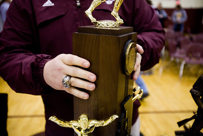 Jenny Kane - jkane@shawmedia.com Wed. Feb. 22, 2012, Prairie Ridge coach Chris Schremp picks up the IHSA Class 6A football state title trophy after an assembly at the high school in Crystal Lake.