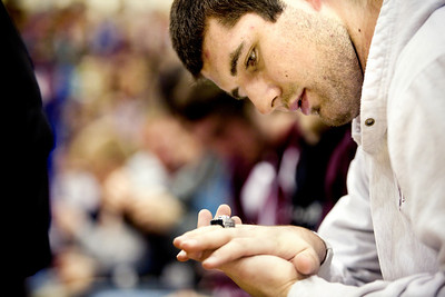 Jenny Kane - jkane@shawmedia.com Wed. Feb. 22, 2012, Prairie Ridge senior tight end and punter Nick Margiotta, looks at his IHSA Class 6A football state title ring after receiving it Wednesday during an assembly at the high school in Crystal Lake.