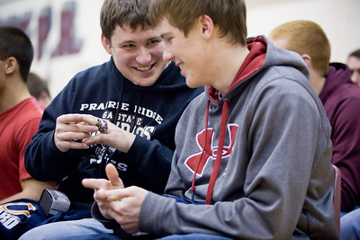 Jenny Kane - jkane@shawmedia.com Wed. Feb. 22, 2012, Prairie Ridge senior Jake Walker, (left) compares his class ring to his the IHSA Class 6A football state title ring to junior Michael VanBosch, (right) after receiving it Wednesday during an assembly at the high school in Crystal Lake.