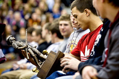 Jenny Kane - jkane@shawmedia.com Wed. Feb. 22, 2012, Prairie Ridge football player junior Jake Touchy looks a the trophy the team received after being named one of the top 50 teams in the nation by the Max PREPS website during a assembly.