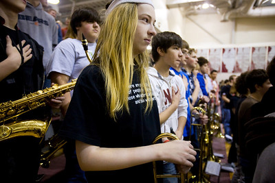 Jenny Kane - jkane@shawmedia.com Wed. Feb. 22, 2012, Prairie Ridge freshman Nigel Ticknor, (center) stands for the playing of the national anthem during an assembly at the high school in Crystal Lake to honor their athletes and the students selected to the All-State choir.