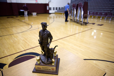 Jenny Kane - jkane@shawmedia.com Wed. Feb. 22, 2012, A trophy the Prairie Ridge football team received after being named one of the top 50 teams in the nation by the Max PREPS website stands in the center of the Prairie Ridge auditorium after an assembly at the high school in Crystal Lake.