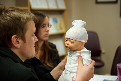 Daniel J. Murphy - dmurphy@shawmedia.com  Greg Cyrul of Woodstock practices wrapping a baby in a blanket in a prenatal class Wednesday February 22, 2012 at the Centegra Hospital in Woodstock. Greg's wife Jamie is pregnant with a due date of March seventh 2012.