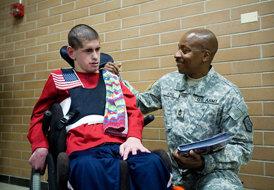 Jenny Kane - jkane@shawmedia.com Wed. Feb. 22, 2012, United States Army veteran James King talks with Scott Maier, of Crystal Lake, during an assembly at the Special Education District of McHenry County Education Center in Woodstock for Take a Veteran to School Day.