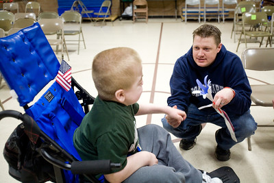 Jenny Kane - jkane@shawmedia.com Wed. Feb. 22, 2012, Coast Guard veteran Jason Paddock, of McHenry, talks with Francis Weir after an assembly at the Special Education District of McHenry County Education Center in Woodstock for Take a Veteran to School Day.