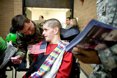 Jenny Kane - jkane@shawmedia.com Wed. Feb. 22, 2012,  Veteran Scott Tanneberger talks with Scott Maier, of Crystal Lake, during an assembly at the Special Education District of McHenry County Education Center in Woodstock for Take a Veteran to School Day.