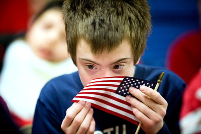 Jenny Kane - jkane@shawmedia.com Wed. Feb. 22, 2012, Leo Anderson feels the American flag an assembly held at the Special Education District of McHenry County Education Center in Woodstock. The assembly had local veterans meet the students and answer questions about their service.