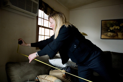 Jenny Kane - jkane@shawmedia.com Thurs. Feb. 23, 2012, Prudential realtor Jackie Nelson measures the dimensions of an apartment that she will being trying to rent out at The Greens of Irish Prairie in McHenry. Nelson has been a realtor for nine years and says that in the past two years the rental market has boomed.