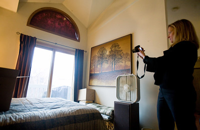 Jenny Kane - jkane@shawmedia.com Thurs. Feb. 23, 2012, Prudential realtor Jackie Nelson takes photographs of an apartment that she will being trying to rent out at The Greens of Irish Prairie in McHenry. Nelson has been a realtor for nine years and says that in the past two years the rental market has boomed.