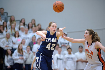 Daniel J. Murphy - dmurphy@shawmedia.com  Cary-Grove's Olivie Jakubicek passes the ball to teammate Alyssa Lee in the fourth quarter Thursday February 23, 2012 at McHenry West High School. DeKalb defeated Cary-Grove 31-29 for the IHSA class 4A sectional title.