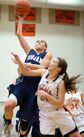 Daniel J. Murphy - dmurphy@shawmedia.com  Cary-Grove's Paige Lincicum (left) atempts a basket over DeKalb's Taylor White (right) in the fourth quarter Thursday February 23, 2012 at McHenry West High School. DeKalb defeated Cary-Grove 31-29 for the IHSA class 4A sectional title.