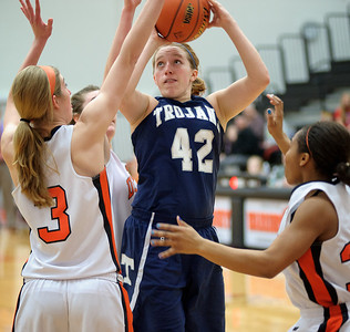 Daniel J. Murphy - dmurphy@shawmedia.com  Cary-Grove's Olivie Jakubicek shoots over DeKalb defenders Courtney Bemis (left) and Courtney Patrick (right) in the third quarter Thursday February 23, 2012 at McHenry West High School. DeKalb defeated Cary-Grove 31-29 for the IHSA class 4A sectional title.