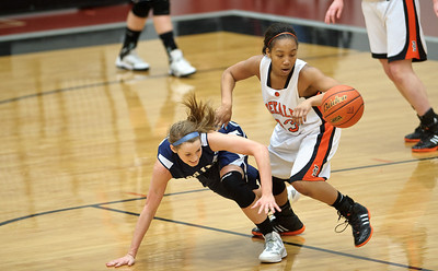 Daniel J. Murphy - dmurphy@shawmedia.com  DeKalb's Courtney Patrick (right) steals the ball from Cary-Grove's Paige Lincicum (left) in the first quarter Thursday February 23, 2012 at McHenry West High School. DeKalb defeated Cary-Grove 31-29 for the IHSA class 4A sectional title.