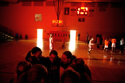Daniel J. Murphy - dmurphy@shawmedia.com  The Cary-Grove girls basketball team huddles up on the court as DeKalb starters are announced Thursday February 23, 2012 at McHenry West High School. DeKalb defeated Cary-Grove 31-29 for the IHSA class 4A sectional title.