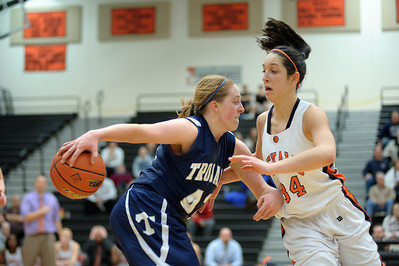 Daniel J. Murphy - dmurphy@shawmedia.com  Cary-Grove's Olivie Jakubicek (left) powers through DeKalb's Rachel Torres (right) in the fourth quarter Thursday February 23, 2012 at McHenry West High School. DeKalb defeated Cary-Grove 31-29 for the IHSA class 4A sectional title.