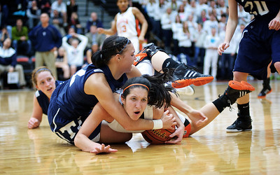 Daniel J. Murphy - dmurphy@shawmedia.com  Cary-Grove's Joslyn Nicholson (top) fouls DeKalb's Rachel Torres (lower) in the fourth quarter Thursday February 23, 2012 at McHenry West High School. DeKalb defeated Cary-Grove 31-29 for the IHSA class 4A sectional title.
