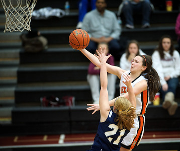 Daniel J. Murphy - dmurphy@shawmedia.com  DeKalb's Taylor White (right) scores a lay-up over Cary-Grove's Sarah Kendeigh in the first quarter Thursday February 23, 2012 at McHenry West High School. DeKalb defeated Cary-Grove 31-29 for the IHSA class 4A sectional title.