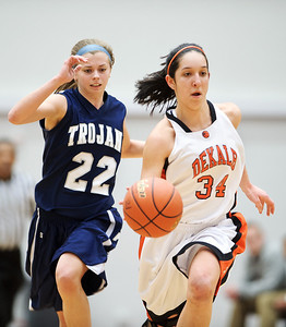 Daniel J. Murphy - dmurphy@shawmedia.com  DeKalb's Rachel Torres (right) zips past Cary-Grove's Megan Leisten (left) in the first quarter Thursday February 23, 2012 at McHenry West High School. DeKalb defeated Cary-Grove 31-29 for the IHSA class 4A sectional title.