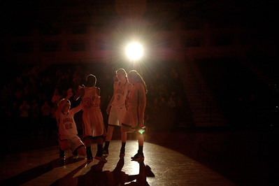 Daniel J. Murphy - dmurphy@shawmedia.com  DeKalb's starters from left: Emily Bemis, Courtney Patrick, Courtney Bemis, and Taylor White gather under the spotlight before facing Cary-Grove Thursday February 23, 2012 at McHenry West High School. DeKalb defeated Cary-Grove 31-29 for the class 4A sectional title.