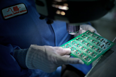 Daniel J. Murphy - dmurphy@shawmedia.com  Carolyn Gliniecki of McHenry performs a final quality assurance inspection on a circuit board Tuesday February 14, 2012 at Phoenix  Manufacturing in Crystal Lake.