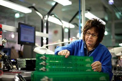 Daniel J. Murphy - dmurphy@shawmedia.com  Linda Walczak of Crystal Lake programs and stacks circuit boards Tuesday February 14, 2012 at Phoenix Manufacturing in Crystal Lake.