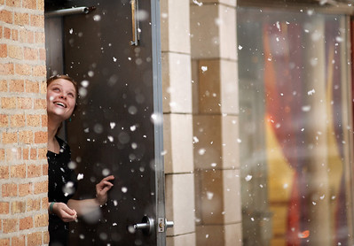 Daniel J. Murphy - dmurphy@shawmedia.com  Caitlin Goss, 21, of Crystal Lake peeks out the kitchen door of Cafe Olympic to catch a glimpse of the falling snow Thursday afternoon February 23, 2012 in Crystal Lake. The National Weather Service has predicted 4 to 8 inches of accumulation overnight.