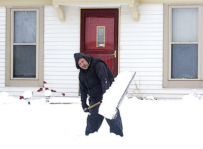 H. Rick Bamman -hbamman@shawmedia.com Algonquin resident Angel Lopez clears the walk in front of his Perry Drive home on Friday morning. Some McHenry County roadways remain slippery, and there have been reports of minor accidents throughout the county.