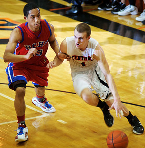 Daniel J. Murphy - dmurphy@shawmedia.com  Crystal Lake Central's Corban Murphy (right) dribbles past Dundee-Crown's Brondon Rodriguez (left) in the third quarter Friday February 24, 2012 at Crystal Lake Central High School in Crystal Lake. Crystal Lake Central defeated Dundee-Crown 61-45.
