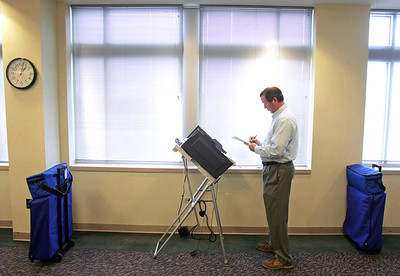 H. Rick Bamman -hbamman@shawmedia.com McHenry County Chief Deputy Clerk Vern Paddock double checks settings on one of six voting machines on the second floor of the administration building on Ware Rd. in Woodstock. Early voting began on Monday February 27.