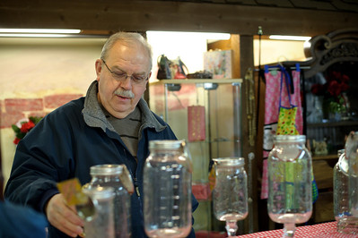 Daniel J. Murphy - dmurphy@shawmedia.com  Bill Magee of Woodstock shops with his wife Leslie at Harbor Bazaar Tuesday February 14, 2012 in McHenry. The shop opened last week, with 13 hand-crafting vendors renting space inside the 800 square foot building. They have a variety of hand-made items for sale, including jewelry and accessories.