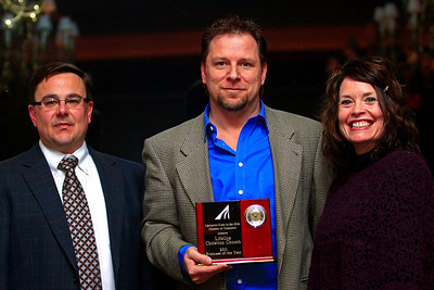Brett Moist - For Shaw Media (from left to right) Russ Farnum and Theresa Sakas pose with Dave Rudin of LifeLine Church after they won the 2011 Business of the Year Award during the annual awards dinner at the Boulder Ridge Country Club in Lake in the Hills on Friday, February 17th. This award ceremony marked 60 years in the community.