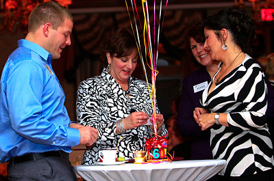 Brett Moist - For Shaw Media (from left to right) Scott Vanderweit, Mary Caporale, Sue Bazdor, and Lou Ho enjoy eachother's company during the annual awards dinner at the Boulder Ridge Country Club in Lake in the Hills on Friday, February 17th. This award ceremony marked 60 years in the community.