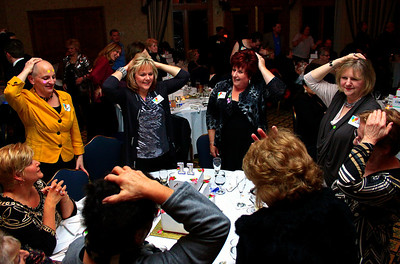 Brett Moist - For Shaw Media Representatives from Your Best Friend's Closet play the heads/tails game during the annual awards dinner at the Boulder Ridge Country Club in Lake in the Hills on Friday, February 17th. This award ceremony marked 60 years in the community.