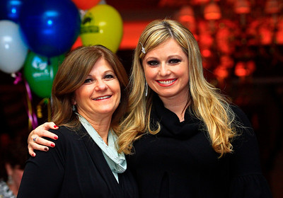 Brett Moist - For Shaw Media (from left to right) Tina Bartolo and her daughter, Deanna Kell pose for a photo during the annual awards dinner at the Boulder Ridge Country Club in Lake in the Hills on Friday, February 17th. This award ceremony marked 60 years in the community.