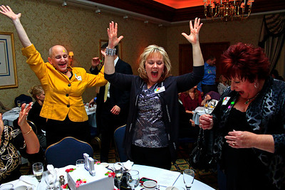 Brett Moist - For Shaw Media (from left to right) Kathleen Wiedenfeld, Marianne Evans, and Amy Pflier enjoy a game of heads/tails during the annual awards dinner at the Boulder Ridge Country Club in Lake in the Hills on Friday, February 17th. This award ceremony marked 60 years in the community.