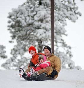 Daniel J. Murphy - dmurphy@shawmedia.com  Zach Thennes (right) of Madison, WI sleds with his kids Jack, 10, (left) and Julia, 5, (front) at Veteran Acres Park Friday afternoon February 24, 2012 in Crystal Lake.