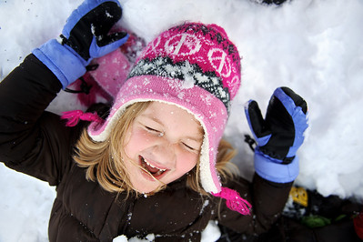 Daniel J. Murphy - dmurphy@shawmedia.com  Emily Cooper, 6, of Crystal Lake plays in the snow with some neighborhood kids after school Friday February 24, 2012 in Crystal Lake.