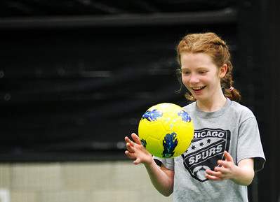 Daniel J. Murphy - dmurphy@shawmedia.com  Caroline Dayon, 10, practices with the Chicago Spurs Soccer Club Monday February 13, 2012 at Sports City Academy in Woodstock.